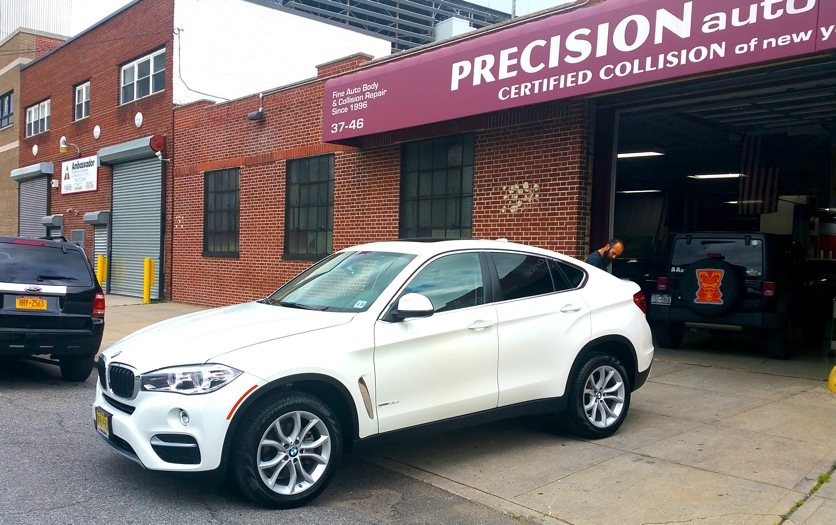 Precision Auto Works of LIC is a BMW factory trained body shop.